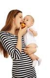 婴孩她的妇女 免版税图库摄影