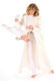 婴孩她的推力母亲 图库摄影
