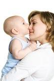 婴孩她的母亲 库存照片