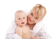 婴孩容忍女孩她的母亲 库存照片