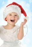 婴孩帽子俏丽的圣诞老人 库存图片