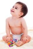 婴孩开会微笑玩具 免版税库存图片
