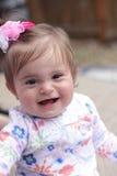 婴孩弓微笑 库存图片