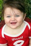 婴孩愉快微笑 免版税库存照片