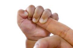 婴孩手指暂挂母亲s 图库摄影