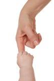 婴孩手指藏品母亲 免版税库存照片