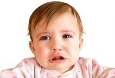 婴孩接近的哭泣的女孩  免版税库存照片
