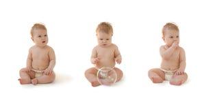 婴孩收集尿布查出坐 免版税图库摄影