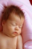 婴孩新出生的睡眠者 免版税库存照片