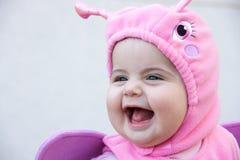 婴孩服装微笑 免版税图库摄影