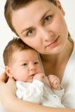 婴孩爱恋的母亲 免版税图库摄影