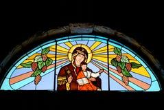 婴孩玻璃耶稣玛丽被弄脏的视窗 免版税图库摄影