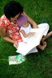 婴孩登记母亲教学 免版税库存照片