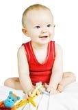 婴孩白肤金发的男孩逗人喜爱坐的微&# 库存图片