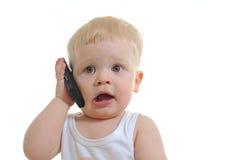 婴孩移动电话联系 图库摄影