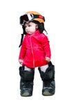 婴孩给风镜挡雪板穿衣 库存照片