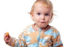 婴孩薄脆饼干吃 免版税库存照片