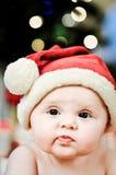 婴孩表面圣诞老人 免版税库存照片
