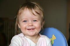 婴孩表面污迹微笑 库存图片