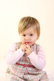 婴孩逗人喜爱的礼服女孩桃红色佩带 图库摄影