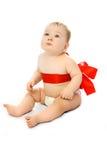 婴孩逗人喜爱的红色丝带 免版税库存图片