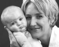 婴孩面颊母亲 库存图片
