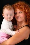 婴孩backgrou黑色女儿她的藏品母亲 库存图片