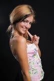 嬉戏的微笑的妇女年轻人 免版税库存图片