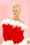 子句女孩性感的圣诞老人 免版税库存照片