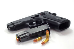 子弹和自动手枪 图库摄影