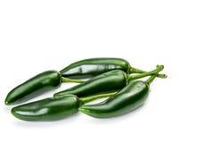 以子弹密击辣椒和墨西哥胡椒胡椒,隔绝在白色 库存图片