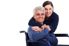 妻子有残障的丈夫 免版税库存图片