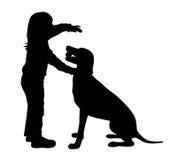 子项和狗 图库摄影