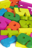 子项在木的玩具上写字 库存照片