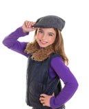 子项开玩笑有盖帽外套和毛皮微笑的冬天女孩 库存图片