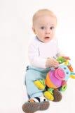 子项拿着在现有量的一个玩具 免版税库存图片
