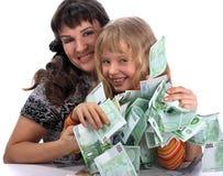 子项拿着货币母亲 库存图片
