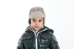 子项给冬天穿衣 免版税库存图片