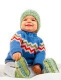 子项给冬天年轻人穿衣 图库摄影
