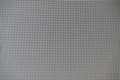 孔的细节patern一块accoustic天花板 免版税库存照片