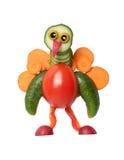 孔雀由新鲜蔬菜做成在白色背景 免版税库存图片