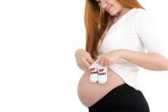 孕妇和小鞋子 库存图片
