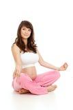 孕妇执行体操。 产科瑜伽。 库存图片