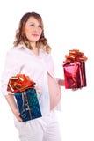 孕妇拿着有礼品的二个配件箱 免版税库存照片