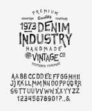 字体牛仔布产业 库存照片