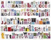 字母表五颜六色的报纸 库存图片