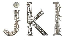 字母表低案件在` j, k, l从金属零件装配的`上写字 免版税库存照片