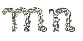 字母表低案件在` m,从金属零件装配的n `上写字 免版税库存照片