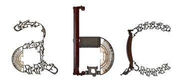 字母表低案件cletters ` a, b, c `从金属零件聚集 图库摄影
