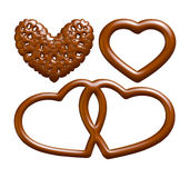 字母表信件、数字和标志由巧克力糖浆制成在被隔绝的白色背景 免版税库存图片